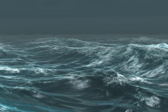 Rough blue ocean under dark sky