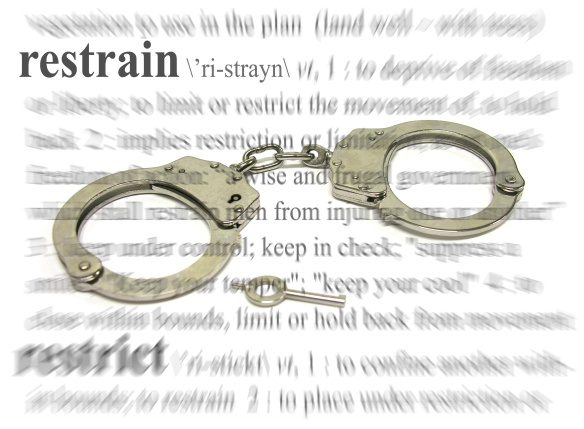 A photo of some handcuffs with a restrain theme