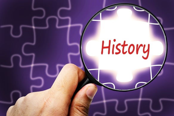 History word. Magnifier and puzzles.